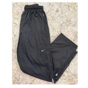 Nike warm up pant mesh lined zip ankle size Medium